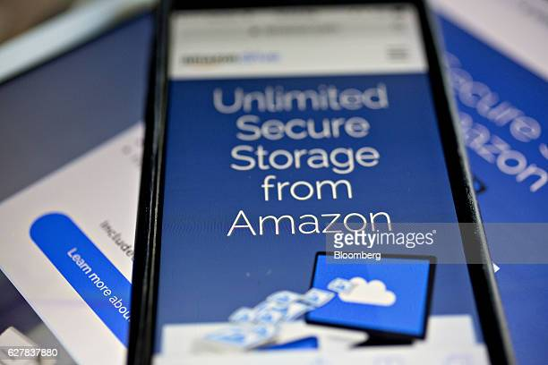The Amazoncom Inc Drive website is displayed on an Apple Inc iPhone and iPad in Washington DC US on Monday Dec 5 2016 Amazoncom unveiled a new...