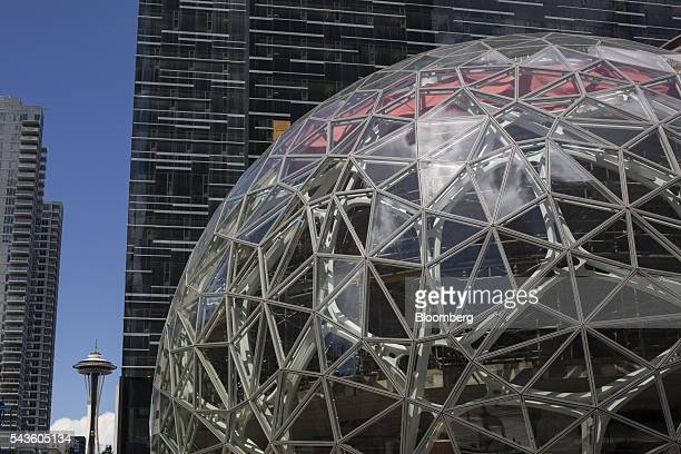 The Amazoncom Inc headquarters stands near the Space Needle in Seattle Washington US on Wednesday June 15 2016 Amazoncom Inc is building three giant...