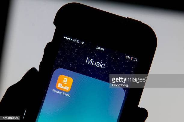 The Amazoncom Inc Prime Music mobile app is displayed on an Apple Inc iPhone 5 for a photograph in San Francisco California US on Thursday June 12...