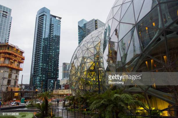 The Amazoncom Inc Spheres right stand during opening day ceremonies at the company's campus in Seattle Washington US on Monday Jan 29 2018 The...