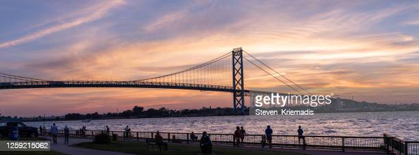the ambassador bridge at dusk - detroit river stock pictures, royalty-free photos & images