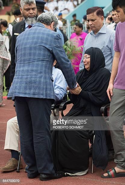 The ambassador of Italy to Bangladesh Mario Palma consoles the mother of a Bangladeshi policeman during a memorial service after armed terrorists...