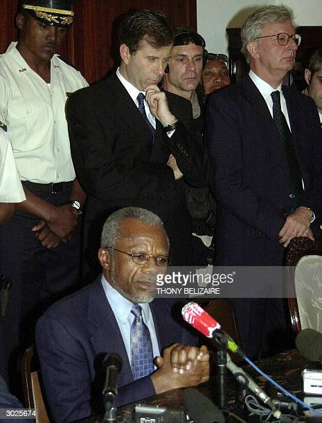 The ambassadors to Haiti from the US James Foley and from France Thierry Bucart listen to Haitian Prime Minister Yvon Neptune as he speaks to...