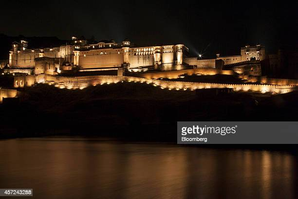 The Amber Fort and Palace stands illuminated at night during the Amber Sound and Light Show in Rajasthan, India, on Monday, Oct. 13, 2014. Indias...