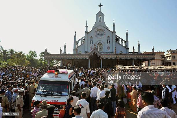 The ambulance transporting the coffin of late nurse Jacintha Saldanha arrives at the Shirve Church for a funeral near Mangalore on December 17 2012...