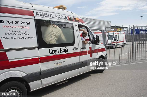 The ambulance with Luis Salom of Spain and SAG Team restarts from medical center after the crashed out during the free practice during the MotoGp of...