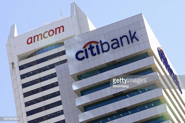 The Amcom Telecommunications Ltd logo is displayed atop St Martins Tower left as it stands next to the Citibank House building in the central...