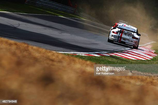 The AMDTUNINGCOM Porsche 911 GT4 of Graham Coomes and Jake Hill drives during the British GT Championship race at Brands Hatch on August 2 2015 in...
