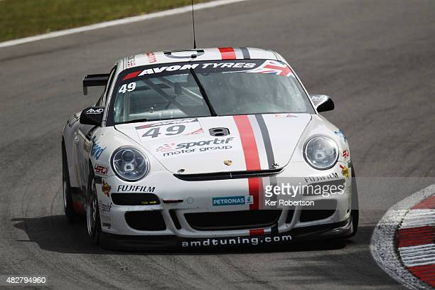The AMDTUNING.COM Porsche 911 GT4 of Graham Coomes and Jake Hill drives during the British GT Championship race at Brands Hatch on August 2, 2015 in...