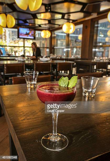 TORONTO ON JUNE 21 The Amelia Eristoff Vodka St Germain Elderflower Liquer Blackberry Puree Lemon Juice Mint at the Speakeasy 21 main floor of Scotia...