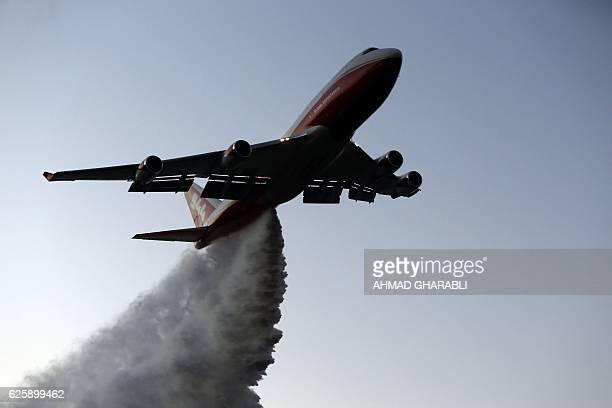 The American 747 supertanker helps extinguish a fire over the village of Nataf close to Jerusalem as it helps extinguish an ongoing fire in the area...