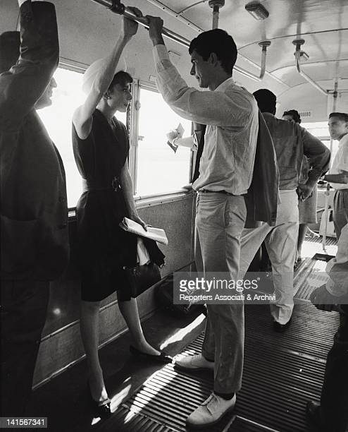 The American actor Anthony Perkins standing on a bus in in the company of British actress Audrey Hepburn Paris July 1962