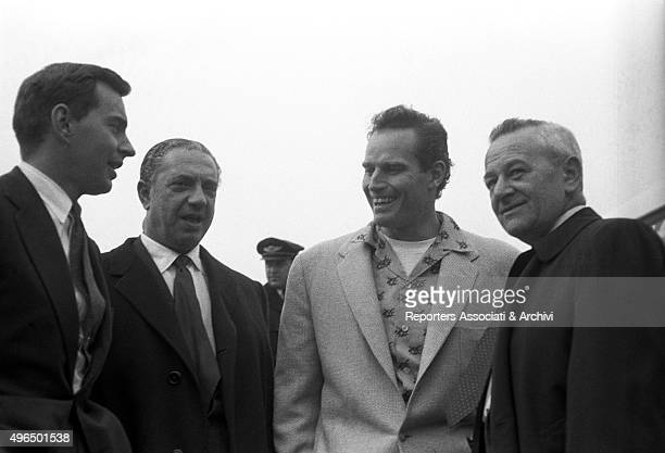 The American actor Charlton Heston arriving at the Ciampino Airport with the the American director William Wyler who is going to direct him in the...