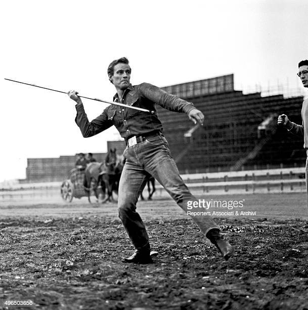 The American actor Charlton Heston training in the throwing of the javelin with the help of a coach on the movie set of Ben Hur outside the Cinecittà...