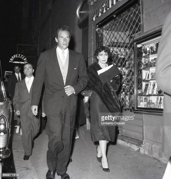 The American actor Charlton Heston walking in Via Veneto with his wife Lydia Marie Clarke in September 1958