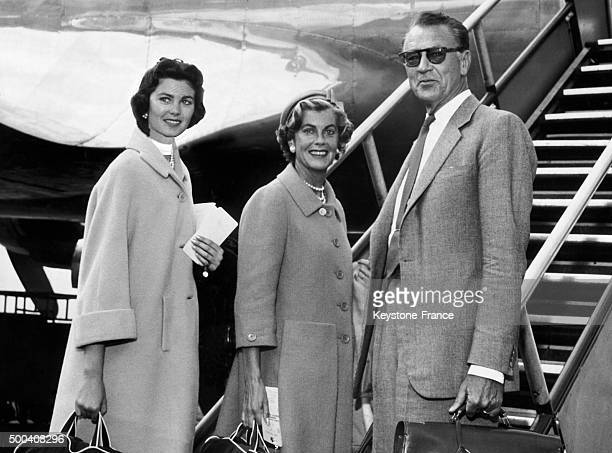 The American actor Gary Cooper his wife Veronica and their daughter Maria ready to take off around 19561957