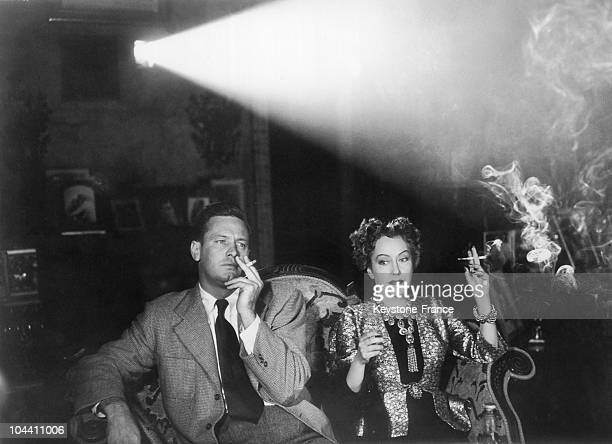 The American actor William HOLDEN and the American actress Gloria SWANSON in a tragic scene of SUNSET BOULEVARD which was produced by Billy WILDER in...