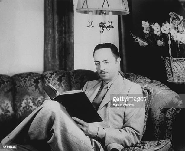 The American actor William Powell in his bachelor apartment