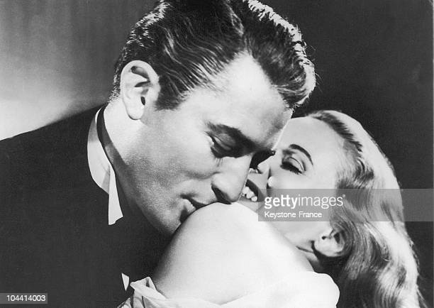 The American actor with the English actress Ann TODD in a scene of Alfred HITCHCOCK's 1947 film THE PARADINE CASE