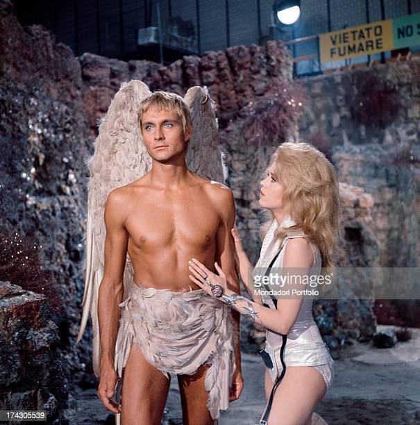 The American actors John Phillip Law and Jane Fonda talk together into Dino De Laurentis Studios during the filming of Roger Vadim's Barbarella Fonda...