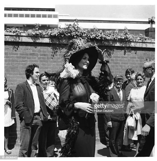 The American actress and author Linda Lovelace wearing transparent black chiffon top at Ascot 1974