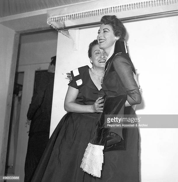 The American actress Ava Gardner hugging the Italian stylist Micol Fontana at a party in her atelier Rome 1957