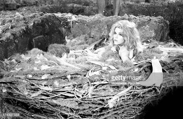 The American actress Jane Fonda playing the charming astronaut Barbarella in the homonymous movie directed by her husband Roger Vadim wakes up...