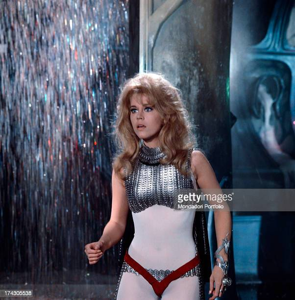 The American actress Jane Fonda wears the clinging space suit of Barbarella the leading role in the homonymous movie directed by her husband Roger...