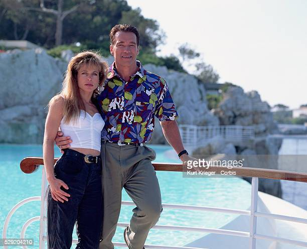 The American actress Linda Hamilton and the Austrianborn actor Arnold Schwarzenegger stand by a pool in Cannes France They have worked together on...