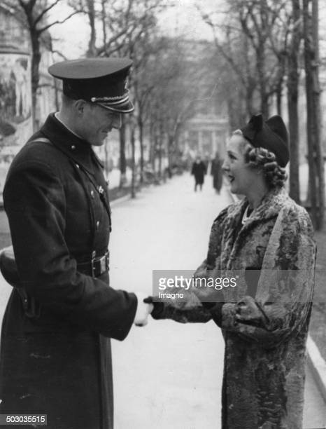 The American actress Mary Pickford talking to a Viennese policeman About 1936 Photograph