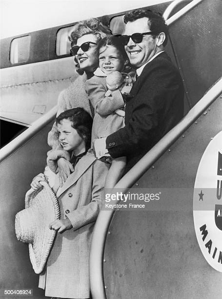 The American actress Rita Hayworth arriving at New York's airport with her latest husband the artist Dick Haymes and her two daughters Rebecca whom...