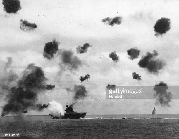 The American aircraft carrier USS Yorktown takes a hit while being bombed in the Battle of Midway June 1942