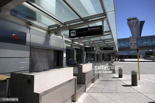The American Airlines curbside baggage counter sits empty at San Francisco International Airport on April 02 2020 in San Francisco California Due to...