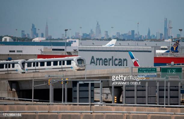 The American Airlines logo is seen at John F Kennedy Airport is seen amid the novel coronavirus pandemic on May 13 2020 in Queens New York