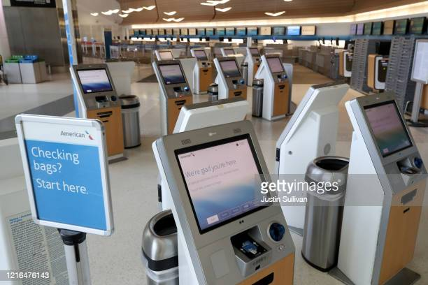 The American Airlines ticket counter sits empty at San Francisco International Airport on April 02 2020 in San Francisco California Due to a...