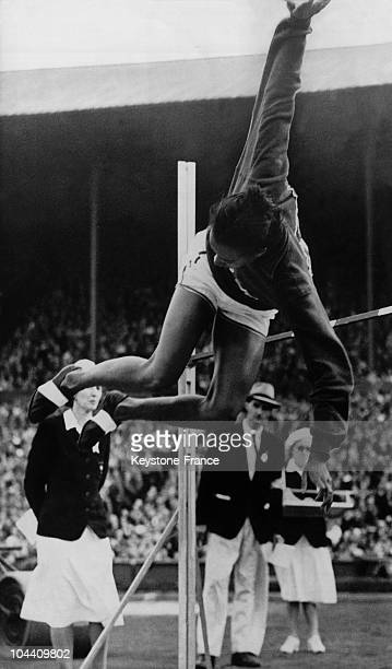 The American Alice COACHMAN in Wembley Stadium setting a new Olympic record in the high jump She crossed the bar at 168 meters