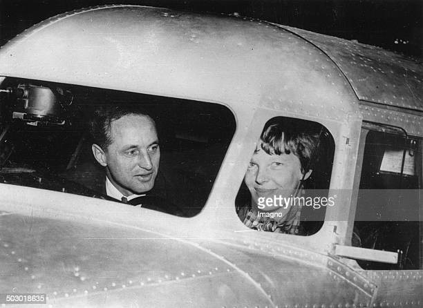 The American Amelia Earhart with her companion Harry Manning a few days before the start of her flight around the equator 13th March 1937 Photograph