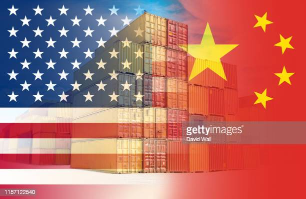 the american and chinese flags imposed over containers representing trade between the two countries. - tariff stock pictures, royalty-free photos & images