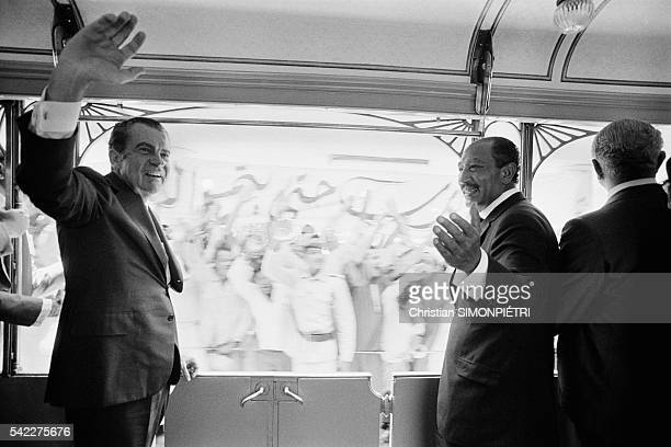 The American and Egyptian Presidents Richard Nixon and Anwar al Sadat travel from Cairo to Alexandria by train greeting crowds gathered along the way