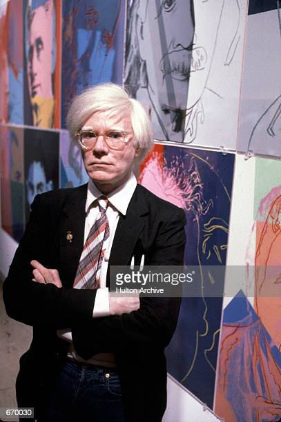 The American artist and filmmaker Andy Warhol with his paintings, December 15, 1980.