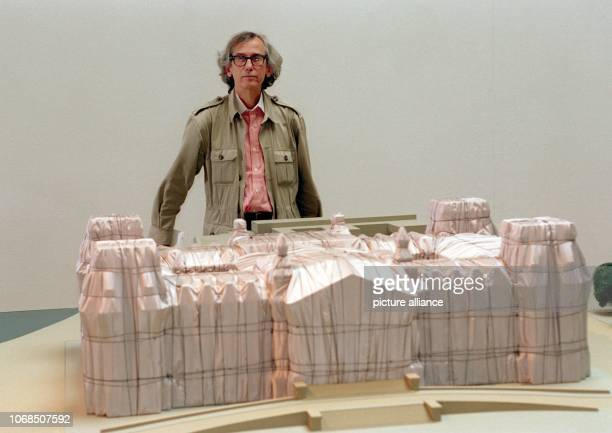 The American artist Christo Javacheff stands behind a model of the veiled Reichstag pictured on 11th May 1994 Munich | usage worldwide