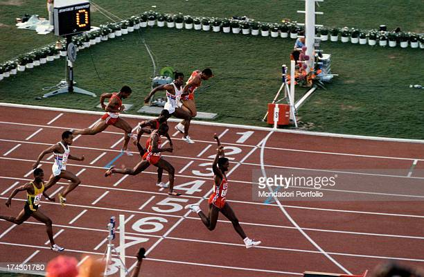 The American athlete Carl Lewis born Frederic Carlton Lewis raises his arms to the sky after crossing the finishing line at the XXIII Olympics Los...