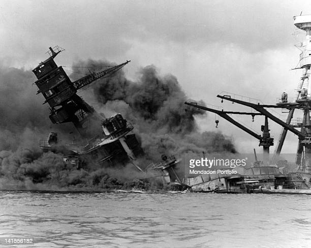 The American battleship 'Arizona' on fire sinking after the Japanese attack on Pearl Harbor Pearl Harbor 7th December 1941
