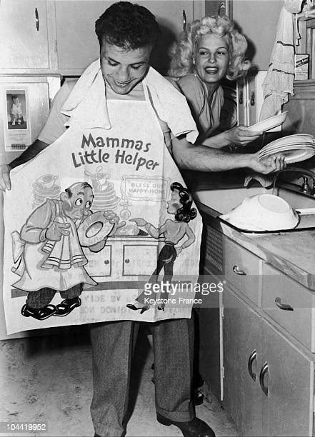 The American Boxer Jake Lamotta And His Wife Vicki Doing The Dishes Together In June 1949 In New York