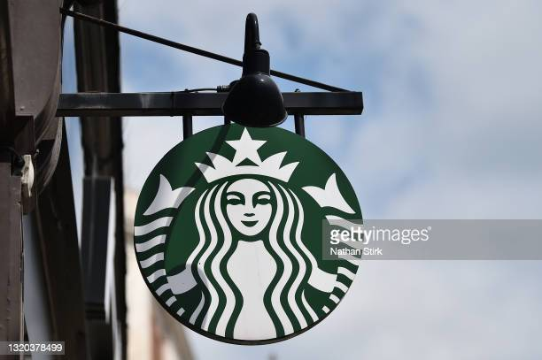 The American Coffeehouse company, Starbucks logo is displayed outside one of its stores on May 27, 2021 in Leeds, England.