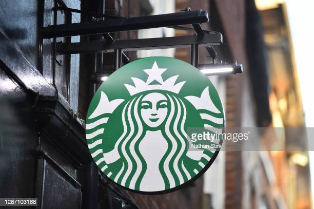The American Coffeehouse company, Starbucks logo is seen outside one of its stores on November 22, 2020 in Stoke-on-Trent, England .