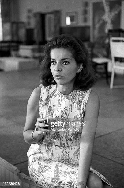 The American dancer and actress Abbe Lane drinking a glass of red wine during a break Madrid 1963
