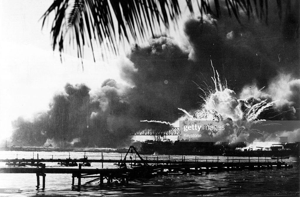 The American destroyer USS Shaw explodes during the Japanese attack on Pearl Harbour (Pearl Harbor), home of the American Pacific Fleet during World War II.