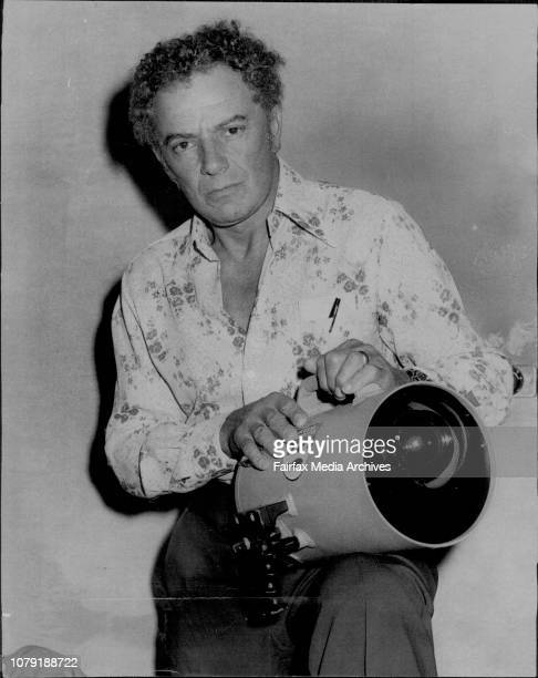 The American film actor Cornel Wilde at Sydney Airport today. He was seeing off his film crew.He is pictured holding an undeerwater film camera with...