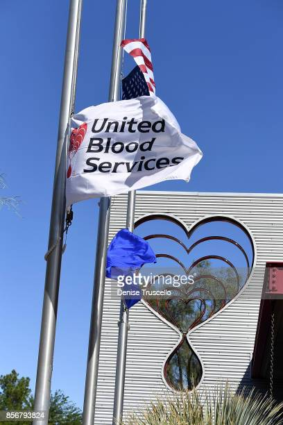 The American flag and the Nevada state flag fly at half-staff at the United Blood Service building, in honor of the victims of the Route 91 Harvest...